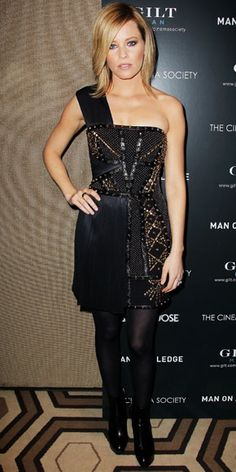 Elizabeth Banks smoldered in a studded neoprene Versace LBD and leather booties