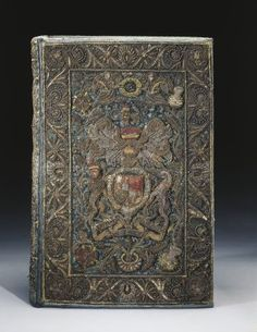 The Holy Bible containing the books of the Old & New Testament ~ 1659-1660 ~ Bound in blue velvet, embroidered with colored silks, silver and silver-gilt wire; the Royal arms ~ a late example of embroidery using metallic threads on velvet. The decoration includes the Stuart arms and the initials CR for Carolus Rex (King Charles II):