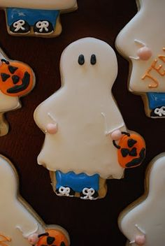 SO CUTE!  Trick-or-treater cookies by The Baking Sheet :D