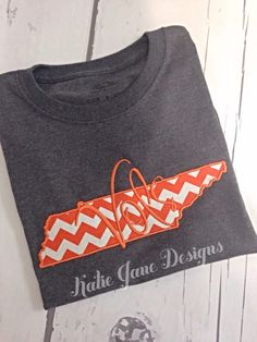 A personal favorite from my Etsy shop https://www.etsy.com/listing/246661566/tn-state-outline-vols-long-sleeve-t