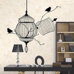 Add some extra class to your living space with this Bird Cage Wall Decal. These wall stickers are removable (not reusable) and stick to walls and other smooth surfaces. Theyre ideal for instantly transforming the look of a room. Installation is simple and easy - just peel and stick!  Sizing  This sticker is on a backing paper measuring 40 x 45cm, which is then peeled off and applied to the wall. The cage is approximately 46cm in height. Transfer paper is included with the decal and…