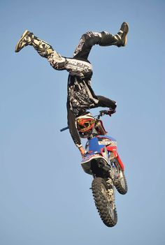 Dean Dotson performs a high-flying motorcycle stunt during the annual Thunder in the Valley motorcycle rally, in Windber, Pa., Friday, June 21, 2013. The rally runs through Sunday, June 23. (AP Photo/Tribune-Democrat, John Rucosky)