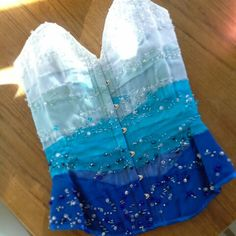 Lovely blue and white and aqua ombre corset with amazing beading by Corsets by Nasty Ginny.