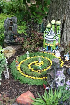 Wizard of Oz fairy garden-Dorothy, Toto, Lion, Scarecrow, Glinda, Wicked Witch of West and East - can you find them all? #fairygardening