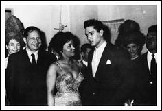 Publisher Jean Aberbach, Nancy Holloway and Elvis at Le Moulin Rouge | During his two-week furlough in the middle of June 1959 Elvis traveled to Paris, France. U.S. singer Nancy Holloway (*December 11, 1932) was very popular in France, doing French versions of pop and soul hits. While attending Nancy Holloway's show at Le Moulin Rouge on Wednesday night, June 17, 1959 Elvis accepted her invitation (She scribbled a short note on a piece of paper) to please meet her backstage afterwards.