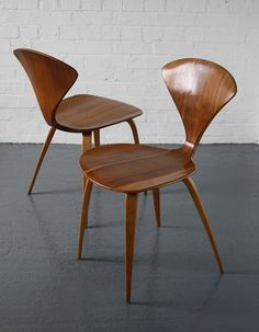 Norman Cherner chairs designed in 1958 for Plycraft, USA. Classic midcentury design. Moulded plywood seats with walnut veneer and bentwood legs.