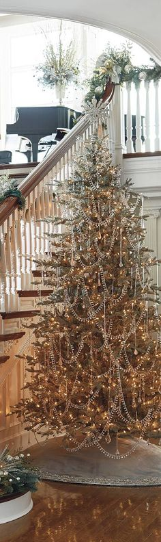 Glittering Christmas Tree near the staircase