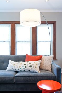 Large Floor Lamp Blue Sofa Orange Accent Stool And Pillow Fun Contemporary