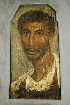 A PAINTED WOOD FAYUM PORTRAIT OF A MAN   roman period, circa 80-140 a.d.   Painted on a wooden panel in the encaustic technique, the panel itself dressed in antiquity in order to accommodate it to the mummy, the portrait that of a moustached and bearded man with short curly hair, the head strongly turned to one side, the eyes looking directly forward, depicted wearing a white chiton with red clavi, over which is worn a mantle  15¼ in. (38.8 cm) high