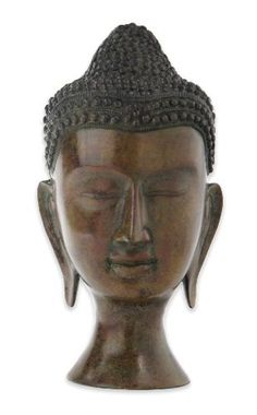 Achla Designs Buddha Bust by Achla. $129.99. Hand cast aluminum. Measures 5-inch  diameter base by 15-inch h. Antique bronze. This traditional buddha bust is the ultimate symbol of wisdom.  The depiction of the half-closed eyes represents a state of meditation: looking outward and inward.  The elongated earlobes represent the ability to hear what is needed in the world.  An incredible image of inspiration, you will feel enlightened at just a glance of this historic...
