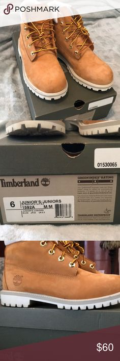 Timberland Boots Tan, waterproof Timberland Boots with a white bottom. Comes with the box. If you wear an 8.5 in women's you could also wear these. I wear an 8.5. They are stained on the inside of the ankle area (shown in pictures) from wearing blue jeans with the boots. Never really wore these. Still look practically brand new. Timberland Shoes