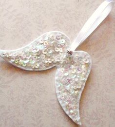 Sparkling sequin angel wings felt decoration-Thoughts. $5.80, via Etsy.