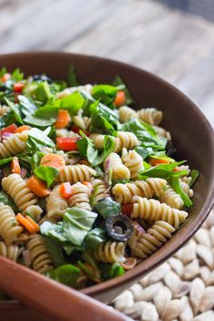 Classic summertime pasta salad lightened up with a mix of chopped baby spinach and veggies, tossed lightly with an easy balsamic vinaigrette.