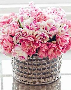 Assorted Pink peonies in silver woven basket.