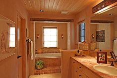 """The master bath at Rio Tesuque is warm in color as well as physically. It is part of the house built with 13"""" E-crete blocks."""