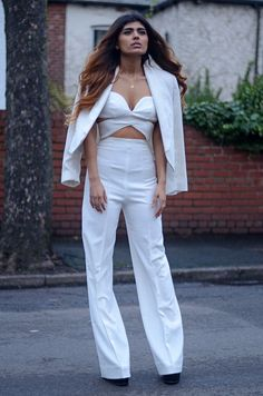 White cut out jumpsuit. // HAATI CHAI