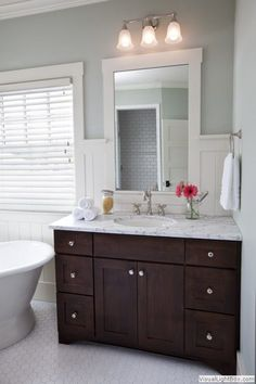 Image result for dark wood and grey bathrooms