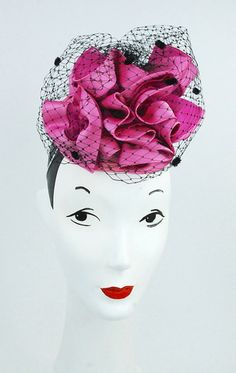 Pink ruffled headpiece with black netting detail