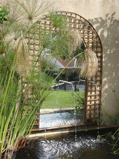 Mirrors creates depth in garden wall