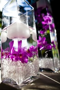 submerged purple orchid wedding centerpieces