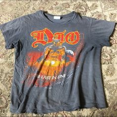 TRUE VINTAGE 1984 DIO TEE Fits a small to medium best. Faded to gray. A few signs of wear but looks great as is! RARE. WILL NOT TRADE. WILL NOT TAKE OFFERS. PRICE IS FIRM. LOWEST PRICE. Vintage Tops Tees - Short Sleeve