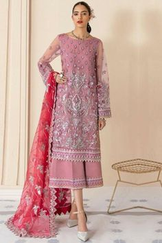 Pull together a chic look when you wear this dusty pink net trouser suit which surely deserves a special place in your wardrobe. This round neck and full sleeve party wear attire highlighted with patch work, sequins and thread work. Teamed up with santoon palazzo pant in dusty pink color with cerise pink net dupatta. Palazzo pant has patch work. Dupatta prettified with silver zari work. #trousersuit #salwarkameez #malaysia #Indianwear #Indiandresses #andaazfashion Pakistani Salwar Kameez, Pakistani Suits, Salwar Suits, Trouser Suits, Trousers, Pantalon Cigarette, Fancy Sarees, Pink Fabric, Festival Wear