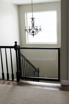 When we moved into our first home, Greta was about 14 months old and we used one of those cheap baby gates for a brief period of time–maybe a month?–before she got the hang of the stairs. I was so hap