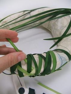 Looping the lily grass around the structure - use a finger nail cuticle pusher to carefully secure any loose strands into the shape