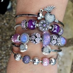 Purple and Pink Pandora passion. Truly my #armparty today! On IG @sarinak23