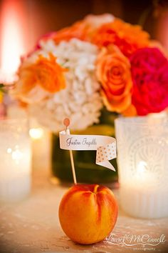 Real fruit makes for unexpectedly sweet placecard holders! We love this pretty peach decoration at @Four Seasons Hotel Seattle.
