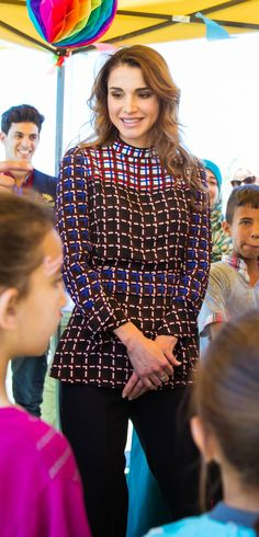 12 June 2016 - Queen Rania meets with volunteers from the Mujaddidun Society for Charity and Development - dress by Marni