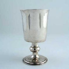 A rare George I ascribed North Country provincial goblet, on a knopped, pedestal foot with a plain, tapering bowl, maker's mark only,struck twice, by Benjamin Brancker, Liverpool 1720-25 5.8in (15cm) high, 6oz. (Woolley and Wallis) North Country, Wallis, Hurricane Glass, Makers Mark, Pedestal, Liverpool, English, Silver, English Language