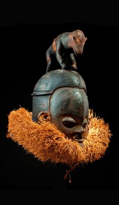 Africa | Mask from the Suku-Zombo people of DR Congo | Wood an natural fiber || Catalogue May 2015