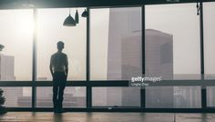 ストックフォト : Businessman looking at cityscape from office