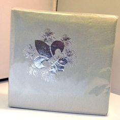 """Gray """"Happy New Year"""" napkins (pack of 25) with metallic silver fleur de lis and fireworks. Imprint reads: """"Happy New Year"""" on fleur de lis."""