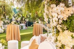 Guests were welcomed into a garden inspired cocktail hour with lush greenery and golden accents.  Design/Décor/Furniture: #EdgarZamora @RevelryEventDesign @RevelryMatias @RevelryAngela @RevelryMilana @RevelryRomina @RevelryLeighC  Creative Team:  Venue: @dolbytheatre   Planner: @mindyweiss     Florals: @marksgarden Photography: Andy Humphries for @simonevankempen_photography   Lighting: @images_lighting   Catering: @chefwolfgangpuck     LED Screen: @CosmosSoundHollywood   Cake: @rafispastry