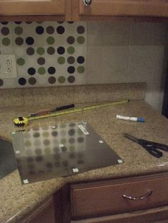 """Ashley's Rowhome: My $13 Kitchen facelift"" Use plastic placemats as backsplash. Mount with sticky tape stuff."
