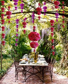 These Tissue Paper Pompoms add course to this beautiful garden setting