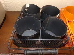 """Primitive Metal Square Black Basket with 4 cans 8"""" Hallowwen / Fall Decor  Primitive Metal Square Black Basket with 4 cans 8"""" These have been in storage , and will be cleaned up , before shipping . Only 3 left . This is for 1 per purchase ."""