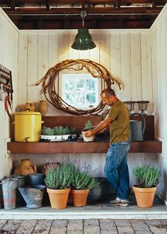 Repurposed corncrib as potting shed. I'm thinking I might use that industrial table I got outside in the backyard...