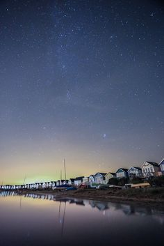 Mudeford at night - Fergus Kennedy | With a beautifully starry sky at the weekend and light winds, I took the opportunity to wade out and set up the tripod in the chilly waters of Christchurch harbour for a long-exposure of the stars and the beach huts. No moon, so the huts are entirely illuminated by the distant lights of Christchurch. Canon 5D Mark III, 17-40 f4 lens at f4, 30s, ISO 6400.