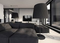 http://boomzer.com/a-solitary-or-family-home-interior-of-grey/convertible-sofa-ideas-black-sofa-black-lamps-downlight-dark-grey-velvet-sofa-large-glass-window-grey-curtains-buoyant-fireplace-white-wood-flooring-glass-coffe-table-teletoskop-open-dining-area-grey/