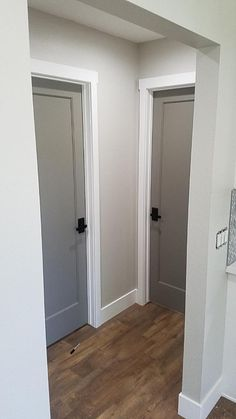 Grey interior doors with oil rubbed bronze hardware. Wall color is Behr mineral. Grey interior doors with oil rubbed bronze hardware. Wall color is Behr mineral. House Design, Interior, Grey Interior Doors, New Homes, Doors Interior, Interior Door Colors, House Interior, Home Renovation, Hallway Designs