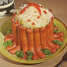 Crown Roast of Frankfurters Reprinted from a Weight Watchers recipe card from 1969.