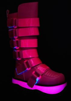 Demonia Neptune UV Reactive Platform Boots you gotta be from a whole other planet, babe...These dope af boots feature a smooth faux-leather construction, UV reactive soles and vinyl strips so you glow in the dark, adjustable straps with velcro closures, super cyber chunky platforms, rounded toes, treaded soles and inner-ankle zipper closures.