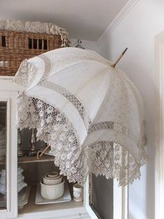 Find a white umbrella, then stitch your lace or ruffles around it. Beautiful!