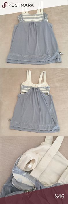 Lululemon Workout Top Lululemon Workout Top. Size 4. Bra top is gray and cream stripe with lace design detail. Bottom is gray with adjustable elastic drawcord at bottom. Bra pads not included. VERY GOOD CONDITION! No trades. lululemon athletica Tops Tank Tops