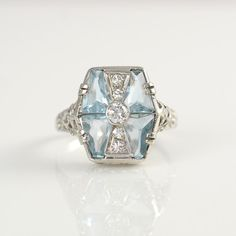 1930s 14K White Gold Ring with Four Aquamarines at 1.25 Carat Total Weight with Accent Diamonds
