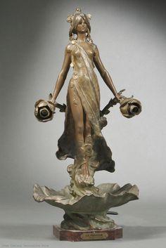 """An Art Nouveau patinated spelter sculptural lamp base """"Le Parfum """" by Louis Moreau, France circa 1900."""