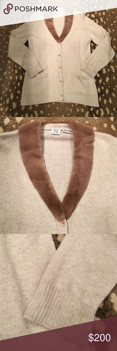 TSE 100% cashmere cardigan with fur collar TSE 100% pure cashmere oatmeal cardigan with fur collar. 💯 % authentic. Pockets on either hip. Wear on sleeves shown in picture that can probably be dry cleaned out. TSE Sweaters Cardigans
